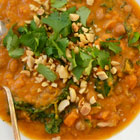 Tomato and peanut soup with sweet potato and chickpeas