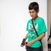 Start your engines! Harman, 11, tests out the Air Hogs Zero Gravity Racer.